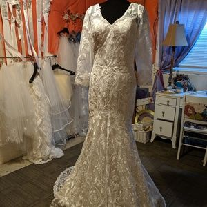 Lace trumpet long sleeved wedding gown